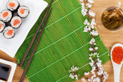 Sushi maki set, green tea and sakura branch Stock Photography