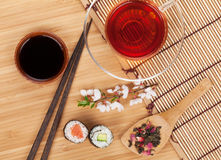 Sushi maki set, herbal tea and sakura branch Stock Images
