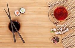Sushi maki set, herbal tea and sakura branch Stock Image