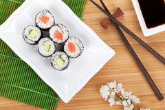 Sushi maki set and sakura branch Stock Photos