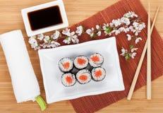 Sushi maki set and sakura branch Royalty Free Stock Image