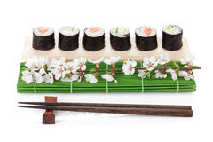 Sushi maki set with salmon and cucumber and sakura branch Stock Image