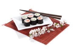 Sushi maki set with salmon and cucumber and sakura branch Royalty Free Stock Photo