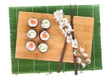 Sushi maki set with salmon and cucumber and sakura branch Stock Image