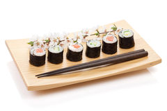 Sushi maki set with salmon and cucumber and sakura branch Stock Photo