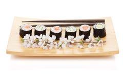 Sushi maki set with salmon and cucumber and sakura branch Stock Photo