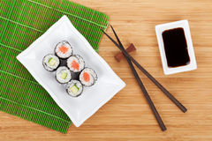 Sushi maki set and soy sauce Stock Images