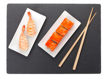 Sushi maki and shrimp sushi on black stone Stock Photos