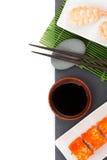 Sushi maki and shrimp sushi on black stone. Isolated on white background with copy space Stock Image