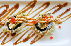 Sushi Maki. Sliced special sushi maki roll with sweet soy sauce splash Stock Photo