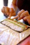 Sushi making process Stock Photos