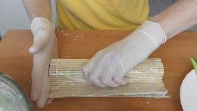 Sushi making process, close up stock footage