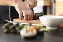 Sushi master prepares futomaki Royalty Free Stock Images