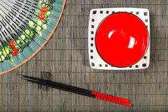 Sushi mat background with plate Royalty Free Stock Photography