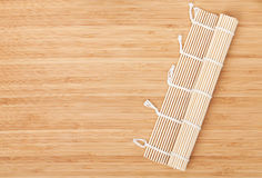 Sushi mat over bamboo table Stock Photography