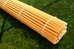 Sushi mat and seaweed. Bamboo sushi mat (used for making sushi) and nori (seaweed Royalty Free Stock Photography