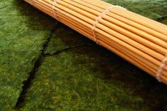 Sushi mat and seaweed royalty free stock photos