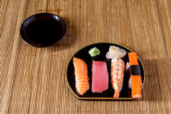 Sushi on mat Royalty Free Stock Images