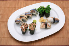 Sushi meal. On a sushi mat royalty free stock photo