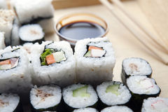 Sushi meal. Delicious sushi set with stick and soy sauce royalty free stock photo