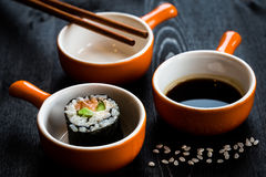 Sushi meal. On dark table royalty free stock images