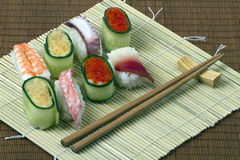 Sushi - meal from seafood. Useful meal from seafood, vegetables and rice Royalty Free Stock Image