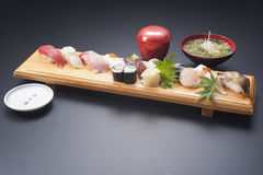 Sushi meal with tuna, rice, fried fish, squid, maki and seaweed Stock Photo