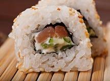 Sushi med havsfisken och grönsaker Fotografering för Bildbyråer