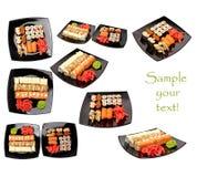 Sushi med ingefäran och wasabi på en svart platta som isoleras på vit Fotografering för Bildbyråer