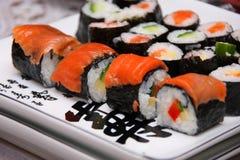 Sushi med laxen Arkivbild