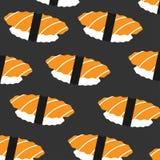 Sushi med laxmodellen på mörk bakgrund Arkivfoto