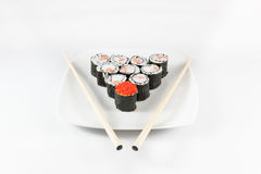 Sushi menu and chopsticks on plate, white background Royalty Free Stock Image