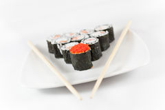 Sushi menu and chopsticks on plate, white background6 Royalty Free Stock Photo
