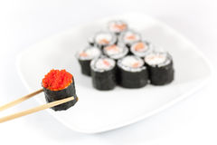 Sushi menu and chopsticks with red caviar Stock Photos