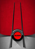 Sushi Menu Design. With a black and red symbol with chopsticks and text Sushi on red and grey velvet background with shadows Stock Photography
