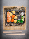 Sushi menu with rolls and nigiri in plastic transport box with chopsticks Stock Photos