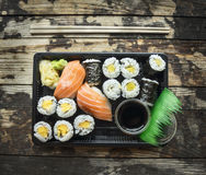 Sushi menu set  in black transport box on dark wooden background, top view Stock Photo