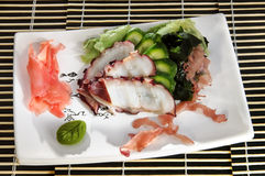 Sushi menu sliced octopus, cucumber and seaweed Royalty Free Stock Photography