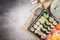 Sushi menu with summer rolls, nigiri , soy sauce and miso soup on gray stone background, top view, place for text. Border stock photography