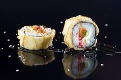 Sushi met bovenste laagjes Stock Fotografie