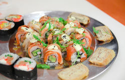 Sushi on the metal plate. Different sushi meal on the metal plate Stock Photos
