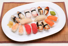 Sushi mix. Meal on a sushi mat royalty free stock photography