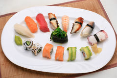 Sushi mix. Meal on a sushi mat royalty free stock photos
