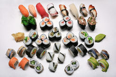 Sushi mix. Different sushi meals on a metal kitchen panel stock images