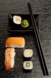 Sushi mix with chopsticks. And wasabi sauce Stock Photos