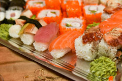Sushi rolls and sashimi Stock Photography