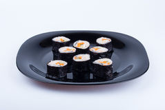 Sushi na placa preta Foto de Stock