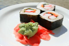 Sushi next to Wasabi and Sushi Ginger Royalty Free Stock Photography