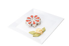 Sushi nicely decorated. Forming hearts  shapes on white square dish isolated on white background Royalty Free Stock Photography