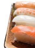 Sushi nigiri. Ceramic dish with four sushi nigiri royalty free stock image